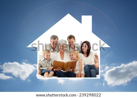 Grandmother reading a book to her family against cloudy sky with sunshine - stock photo