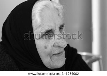 Grandmother remembers memories  - stock photo