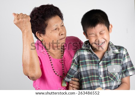 grandmother scolds her grandson. - stock photo