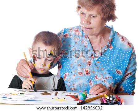Grandmother teaches his grandson drawing isolated - stock photo