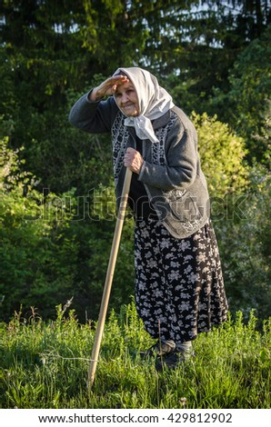 grandmother the pensioner on walk - stock photo