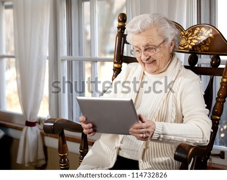Grandmother Using Tablet Computer - stock photo
