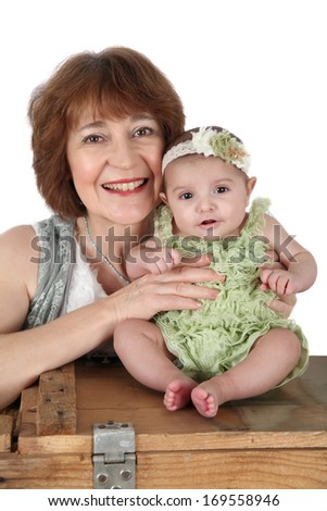 Grandmother with a three month old baby girl - stock photo