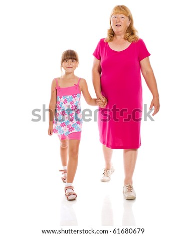 Grandmother with child walking together isolated on white - stock photo