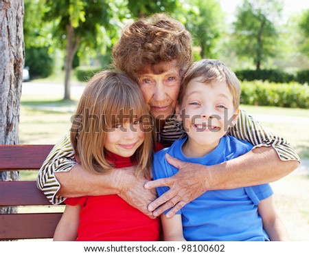 Grandmother with grandchild. Old woman with children - stock photo