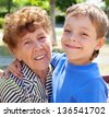 Grandmother with grandchild. Old woman with grandson - stock photo