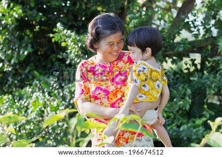 Grandmother with grandchild. Old woman with grandson in garden ,asian people ,thailand - stock photo