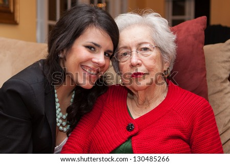 Grandmother with granddaughter in a home setting. - stock photo