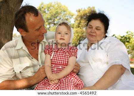 Grandmother with grandfather and granddaughter - stock photo