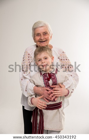 Grandmother with grandson. Grandmother hugging granddaughter. - stock photo