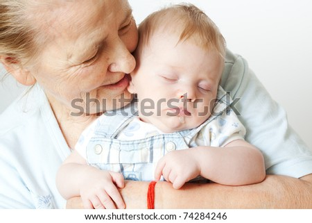 grandmother with her little grandson - stock photo