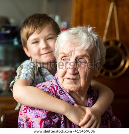 Grandmother with her little grandson, closeup portrait. - stock photo