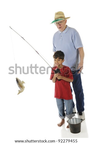 Grandpa's impressed by the fish his preschool grandson caught.  On a white background. - stock photo