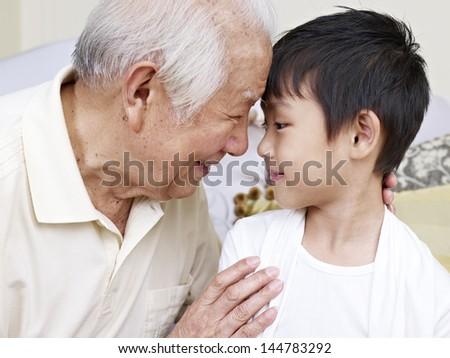 grandpa talking to grandson. - stock photo