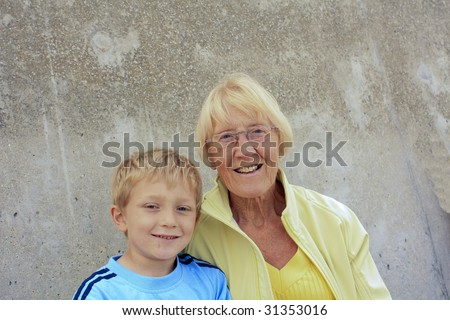 grandparent and grandson on the beach