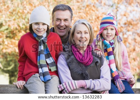 Grandparents and grandchildren on autumn walk - stock photo