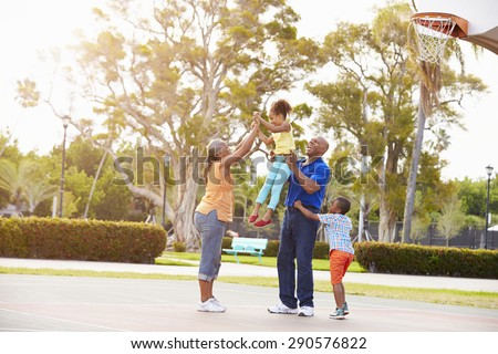 Grandparents And Grandchildren Playing Basketball Together - stock photo