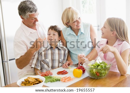 Grandparents And Grandchildren Prepare A meal,mealtime Together