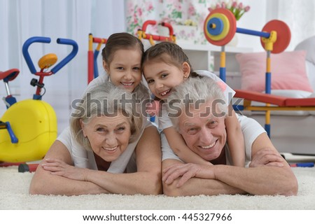 grandparents  and  granddaughters doing exercise - stock photo