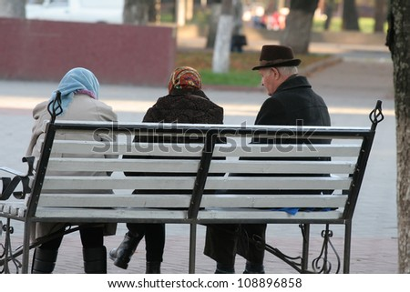 Grandparents are sitting on the bench