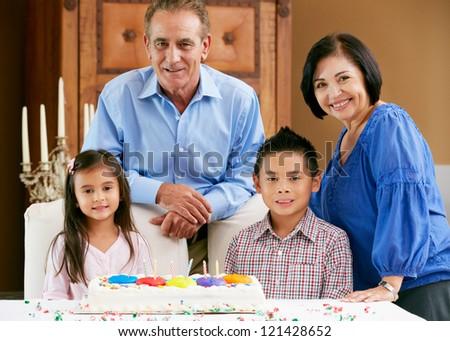 Grandparents Celebrating Children's Birthday - stock photo