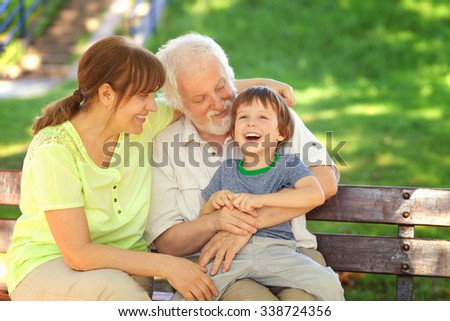 Grandparents having great fun with their grandchild - stock photo