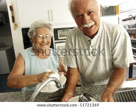 grandparents in a kitchen - stock photo