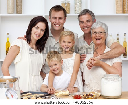 Grandparents, parents and children baking in the kitchen - stock photo
