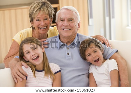 Grandparents posing with grandchildren - stock photo