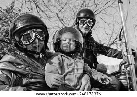 Grandparents with cute little girl in sidecar bike - stock photo