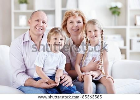 Grandparents with grandchildren at home - stock photo