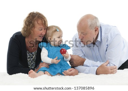 grandparents with granddaughter, isolated on white background - stock photo