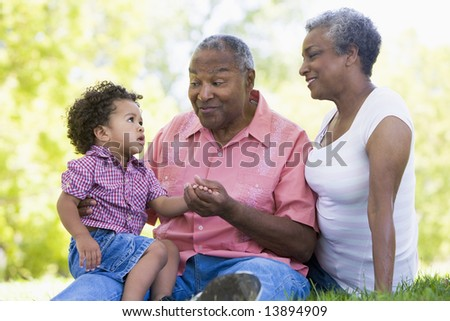 Grandparents with grandson in park - stock photo