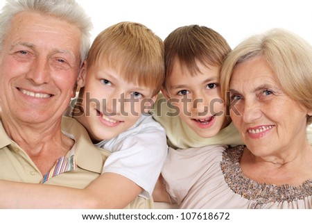 Grandparents with their good grandchildren on a white background - stock photo