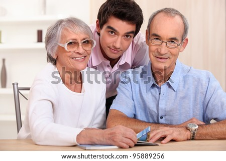 Grandson posing with his grandparents