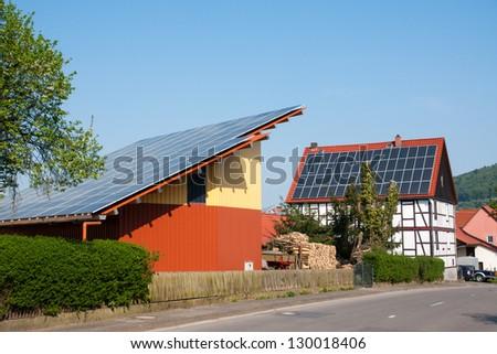 Grange with solar panels - stock photo