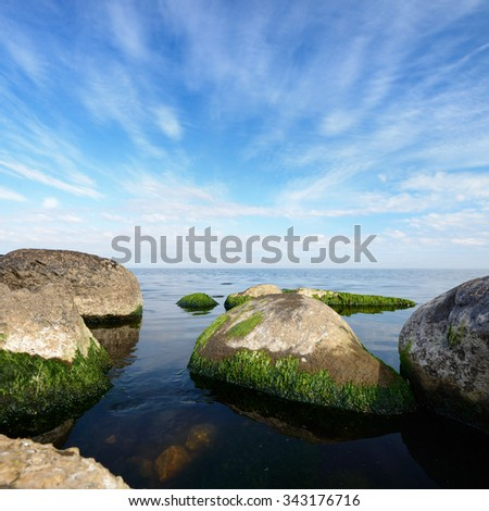 Granite boulders in Baltic sea on a sunny summer day