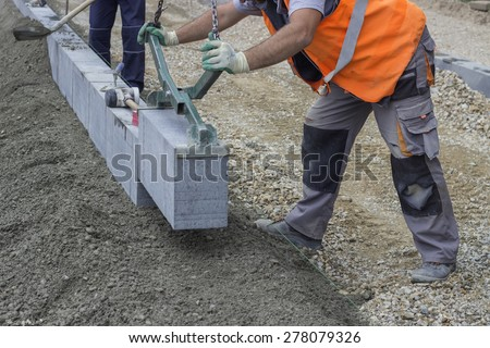 Granite curbing installation, vertical curbing. Selective focus and shallow dof.  - stock photo