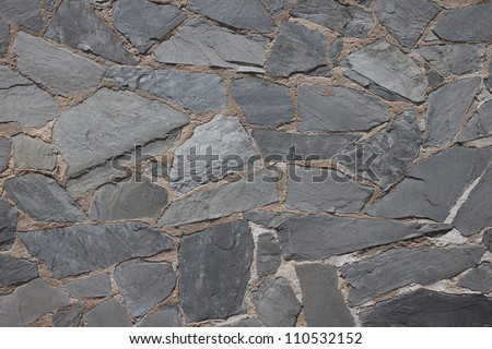 Granite flagstone pavement wall background - stock photo