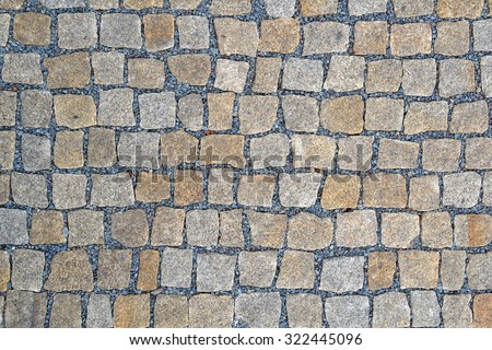 Granite new small cobblestone pavers. - stock photo