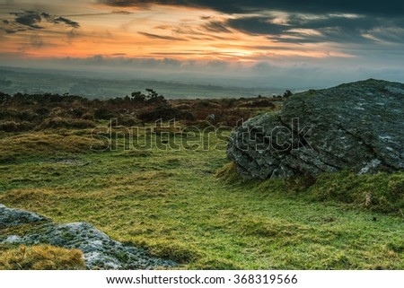 Granite outcrop rock in Dartmoor,UK at dramatic sunset - stock photo