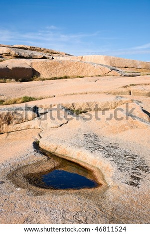 Granite rock with water puddle