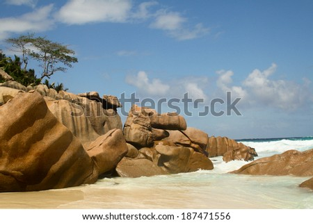 Granite stones on the beach, La Digue, Seychelles - stock photo
