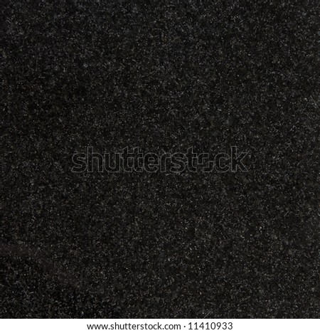 Granite texture, Absolute Black variety, close-up - stock photo