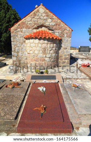 Granite tombstone behind orthodox monastery near the Adriatic sea - stock photo