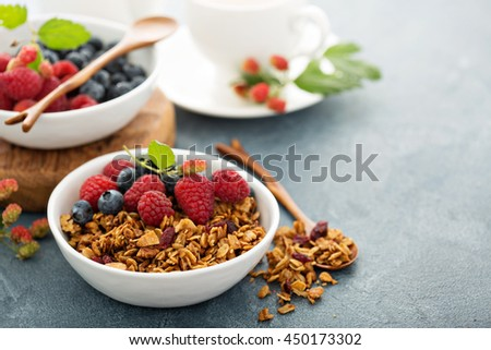 Granola and fresh berries with coffee for healthy breakfast