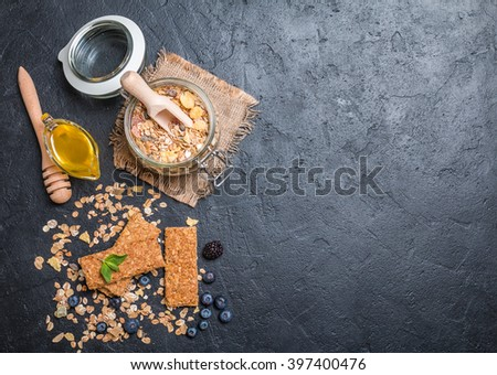 Granola bar from homemade granola with honey on black background, top view - stock photo