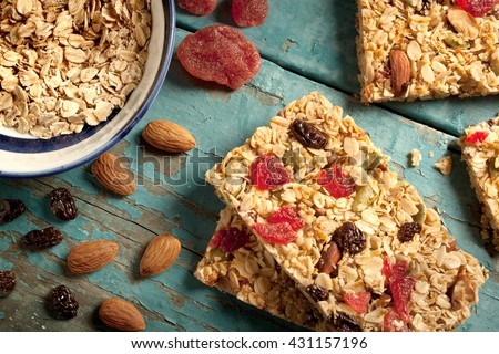 Granola bar on a blue wooden background - stock photo