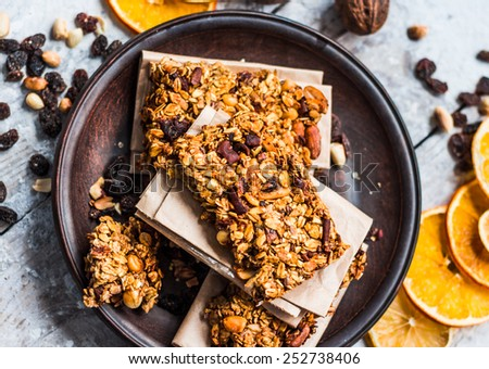 granola bars citrus, peanut butter and dried fruit, Healthy eating concept with cereal bar - stock photo