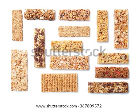 Granola bars with cereals and dried fruit isolated on white background - stock photo